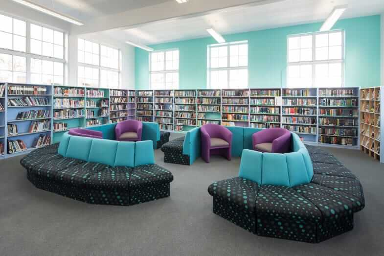 carshalton_9860 Easy seating in a library with coloured shelving